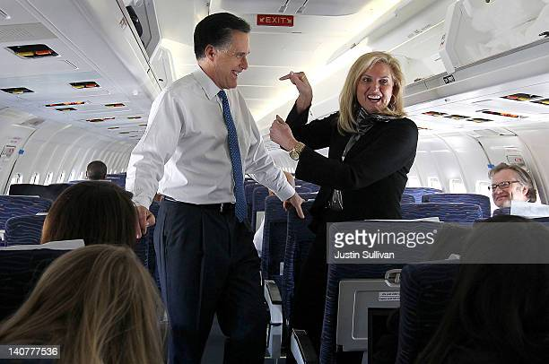 Republican presidential candidate and former Massachusetts Gov Mitt Romney and his wife Ann Romney talk to members of the media aboard his campaign...
