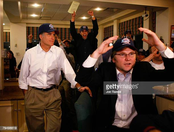 Republican presidential candidate and former Massachusetts Gov Mitt Romney and his traveling press secretary Eric Fehrnstrom react as they watch the...