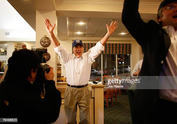 Republican presidential candidate and former Massachusetts Gov Mitt Romney reacts as he watches the New England Patriots score in the 4th quarter of...