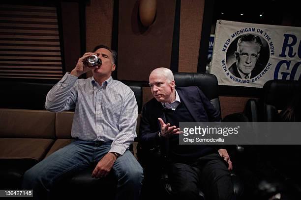 Republican presidential candidate and former Massachusetts Governor Mitt Romney talks with former presidential nominee US Sen John McCain on Romney's...