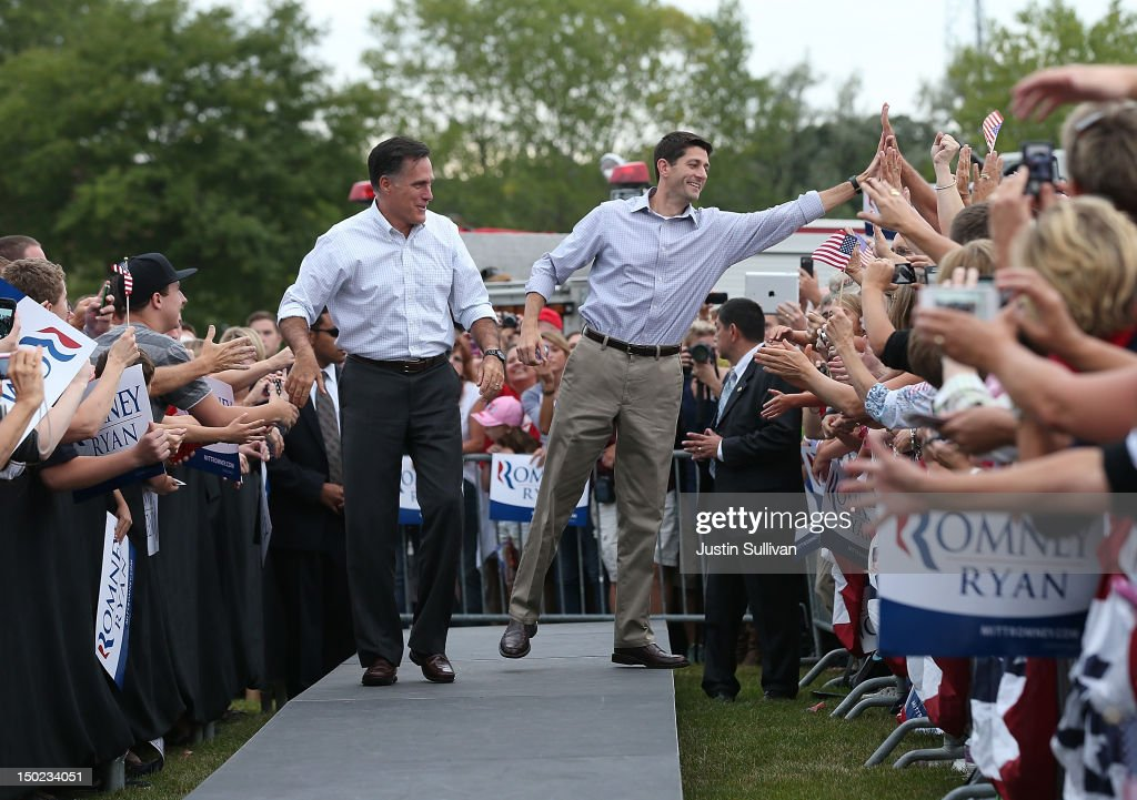 Republican presidential candidate and former Massachusetts Governor Mitt Romney (L) and his running mate Rep. Paul Ryan (R-WI) greet supporters during a homecoming campaign rally at the Waukesha County Expo Center on August 12, 2012 in Waukesha, Wisconsin. Mitt Romney continues his four day bus tour a day after announcing his running mate, Rep. Paul Ryan (R-WI).