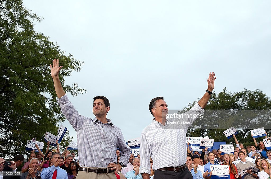 Republican presidential candidate and former Massachusetts Governor Mitt Romney (R) and his running mate Rep. Paul Ryan (R-WI) greet supporters during a homecoming campaign rally at the Waukesha County Expo Center on August 12, 2012 in Waukesha, Wisconsin. Mitt Romney continues his four day bus tour a day after announcing his running mate, Rep. Paul Ryan (R-WI).