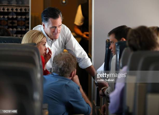 Republican presidential candidate and former Massachusetts Governor Mitt Romney talks with US Sen Marco Rubio and Florida attorney general Pam Bondi...