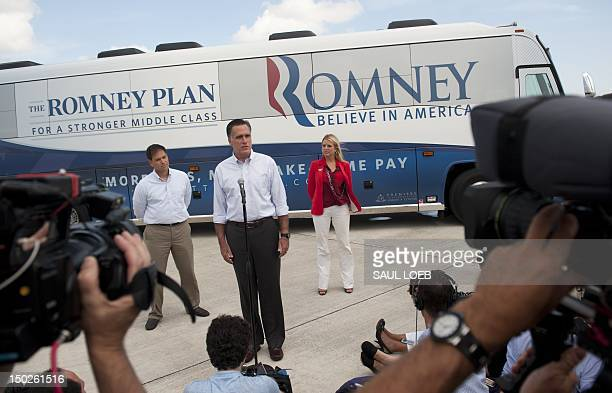 US Republican presidential candidate and former Massachusetts Governor Mitt Romney speaks alongside Florida Republican Senator Marco Rubio and...