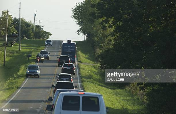 US Republican presidential candidate and former Massachusetts Governor Mitt Romney's campaign bus and motorcade drive to a campaign event at the Ross...