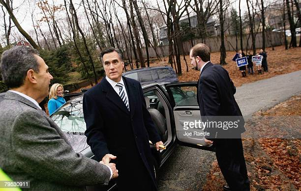 Republican presidential candidate and former Massachusetts governor Mitt Romney and his wife Ann Romney enter their car after voting at City Hall...