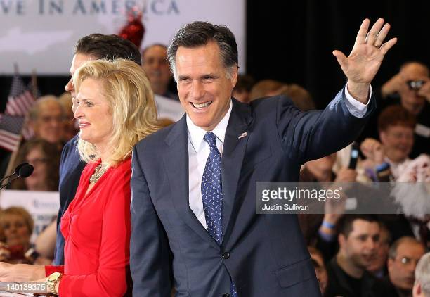 Republican presidential candidate and former Massachussetts Gov. Mitt Romney waves to supporters during a primary night gathering at the Suburban...