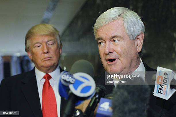 Republican presidential candidate and former Speaker of the House Newt Gingrich speaks to the media as Donald Trump listens at Trump Tower following...