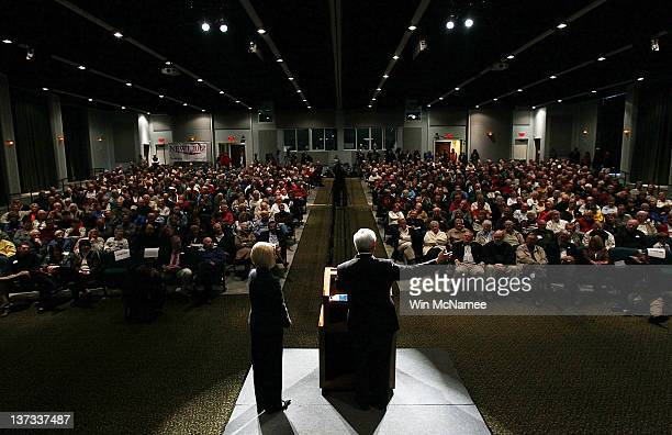 Republican presidential candidate and former Speaker of the House Newt Gingrich speaks during a Town Hall meeting as his wife Callista Gingrich...