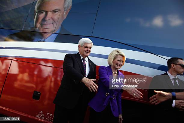 Republican presidential candidate and former Speaker of the House Newt Gingrich and his wife Callista Gingrich greet supporters and pose for...