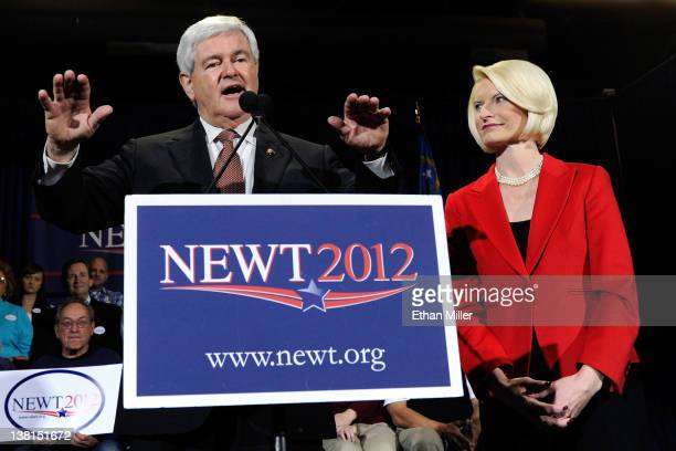Republican presidential candidate and former Speaker of the House Newt Gingrich is accompanied by his wife Callista Gingrich as he speaks at a...
