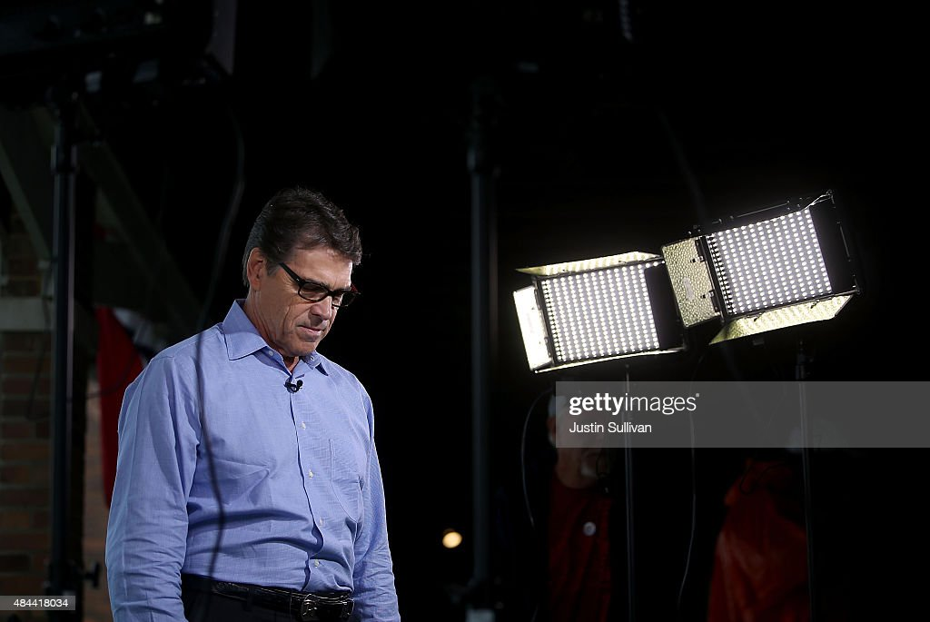 Republican presidential candidate and former Texas Gov. Rick Perry pauses after conducting a television news interview at the Iowa State Fair on August 18, 2015 in Des Moines, Iowa. Presidential candidates are addressing attendees at the Iowa State Fair on the Des Moines Register Presidential Soapbox stage and touring the fairgrounds. The State Fair runs through August 23.