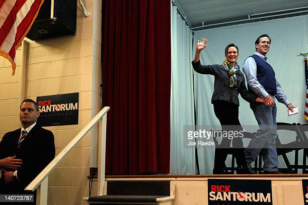 Republican presidential candidate and former U.S. Sen. Rick Santorum and his wife Karen Santorum arrive together for a campaign rally at an American...