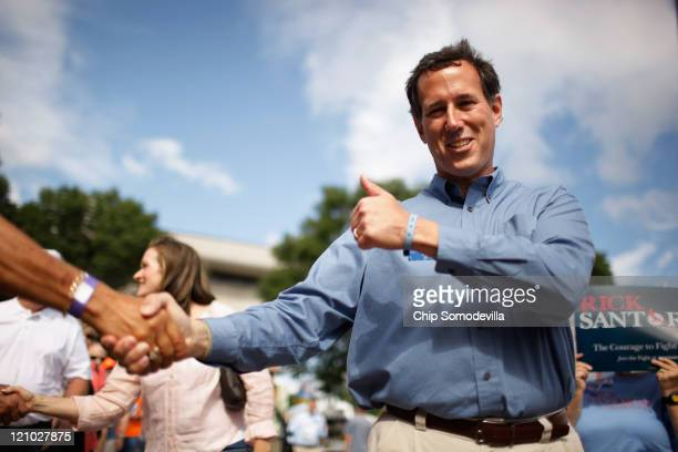 Republican presidential candidate and former US Senator Rick Santorum greets voters outside the Hilton Coliseum where Iowans will vote in the Iowa...