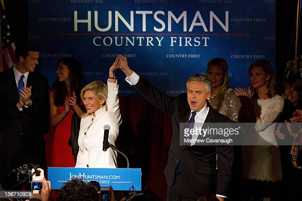 Republican presidential candidate and former Utah Gov Jon Huntsman takes the stage with his wife Mary Kaye and family during a primary night rally at...