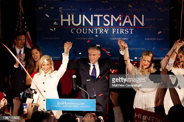 Republican presidential candidate and former Utah Gov. Jon Huntsman celebrates on stage with his son in law Jeff Livingston, daughter Abby...