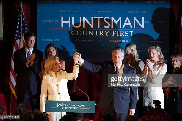 Republican presidential candidate and former Utah Gov Jon Huntsman celebrates on stage with his son in law Jeff Livingston daughter Abby Livingston...