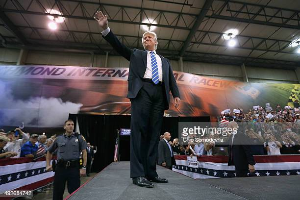 Republican presidential candidate and frontrunner Donald Trump walks out on stage during a campaign rally at the Richmond International Raceway...