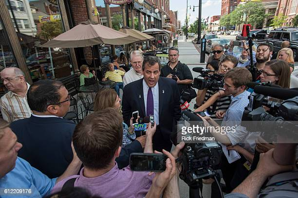 Republican presidential candidate and New Jersey Governor Chris Christie addressing the media after campaigning at Martha's Exchange restaurant in...