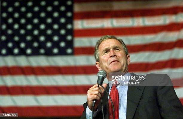 Republican presidential candidate and Texas Governor George W Bush delivers a campaign speech to a gymnasium full of supporters at Valley High School...