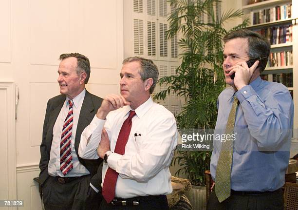 Republican presidential candidate and Texas Governor George W Bush his brother Florida Governor Jeb Bush and their father former president George...