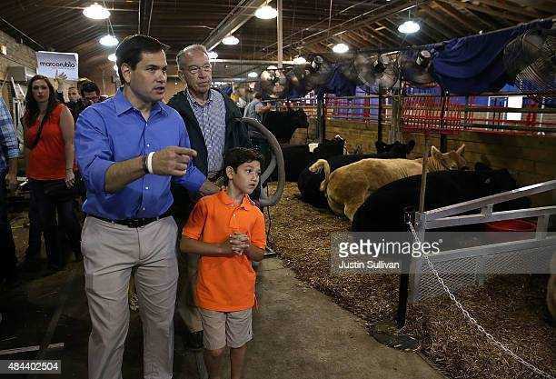Republican presidential candidate and US Sen Marco Rubio US Sen Chuck Grassley and Anthony Rubio tour the Iowa State Fair on August 18 2015 in Des...