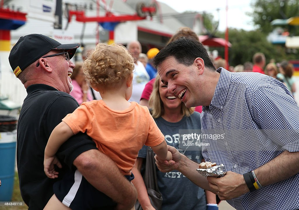 Republican presidential candidate and Wisconsin Gov. Scott Walker (R) greets fairgoers while touring the Iowa State Fair on August 17, 2015 in Des Moines, Iowa. Presidential candidates are addressing attendees at the Iowa State Fair on the Des Moines Register Presidential Soapbox stage and touring the fairgrounds. The State Fair runs through August 23.