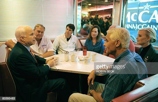 Republican presidential candidate Arizona Sen John McCain meets with local business owners at the Starlite Diner coffee shop in Daytona Beach Florida...