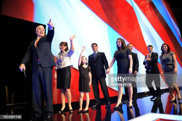 Republican presidential candidate Arizona Senator John McCain gestures before leaving the stage with his running mate Alaska Governor Sarah Palin and...