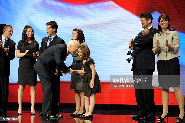 Republican presidential candidate Arizona Senator McCain greets Piper Palin the youngest daughter of his running mate Alaska Governor Sarah Palin...