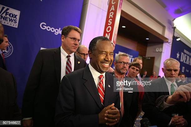 Republican Presidential candidate Ben Carson speaks with the media in the spin room after finishing his Republican Presidential debate sponsored by...