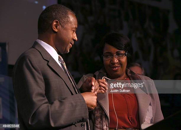 Republican presidential candidate Ben Carson stands with his wife Candy Carson during a Distinguished Speakers Series event at Colorado Christian...