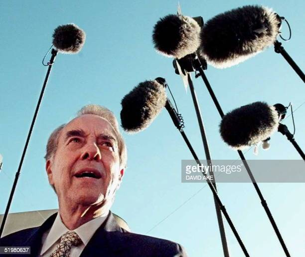 Republican presidential candidate Bob Dole is surrounded by boom microphones after a campaign rally in downtown Merced California 26 October Dole is...