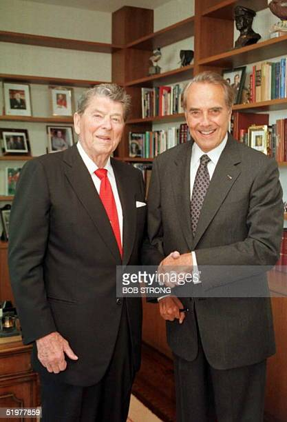 Republican presidential candidate Bob Dole shakes hand with former US President Ronald Reagan at Reagan's office in Century City 03 July Dole met...