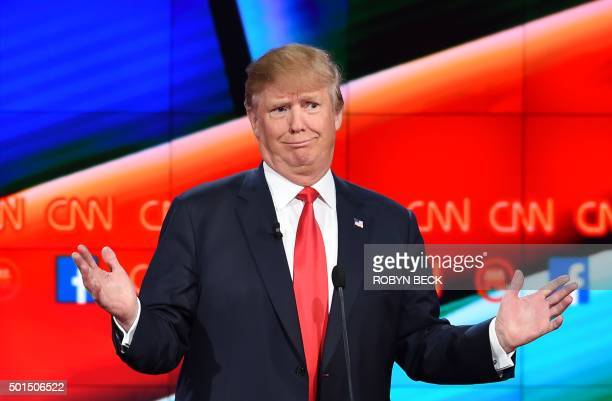 TOPSHOT Republican presidential candidate businessman Donald Trump gestures during the Republican Presidential Debate hosted by CNN at The Venetian...