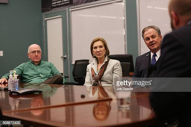 Republican presidential candidate Carly Fiorina and her husband sit with members of the leadership team at Dyn a cloudbased Internet Performance...