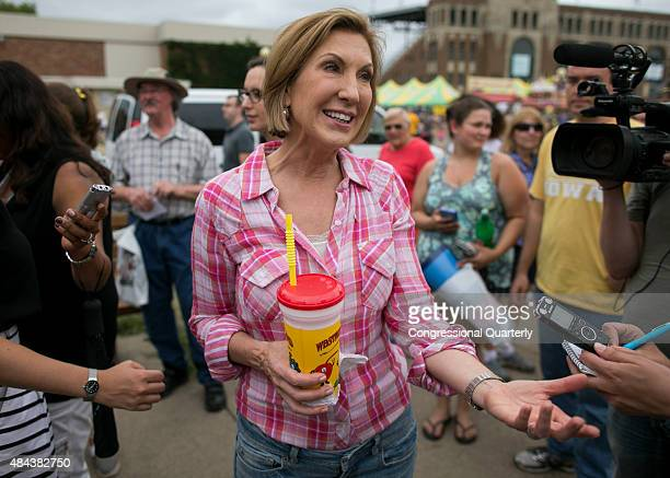 Republican presidential candidate Carly Fiorina answers questions from reporters while holding her diabetic lemonade at the Iowa State Fair in Des...