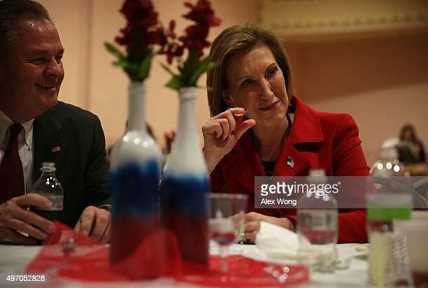 Republican presidential candidate Carly Fiorina chats Iowans as her husband Frank Fiorina looks on during the 2015 Lincoln Dinner of Adair County...
