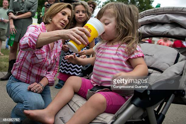 Republican presidential candidate Carly Fiorina shares her diabetic lemonade with Teresa Tehoke as her sister Maire watches at the Iowa State Fair in...