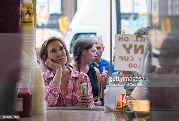 Republican presidential candidate Carly Fiorina waits her turn in line to purchase a diabetic lemonade at the Iowa State Fair in Des Moines Iowa...