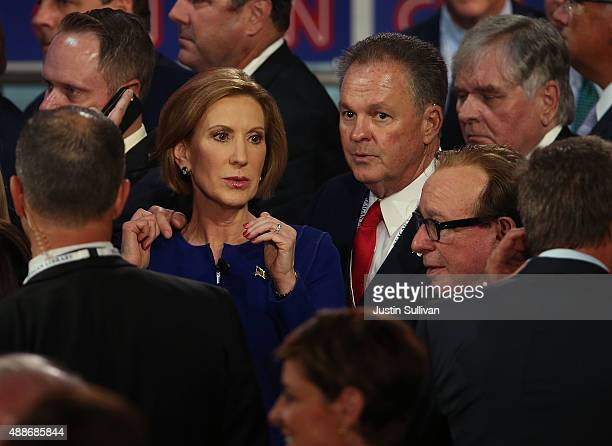 Republican presidential candidate Carly Fiorina walks with her husband Frank Fiorina at the presidential debates at the Reagan Library on September...