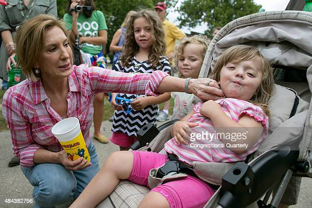 Republican presidential candidate Carly Fiorina wipes up spilled diabetic lemonade off of Teresa Tehoke as her sisters Maire center left and Brigid...