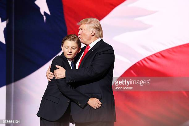 Republican presidential candidate Donald embraces his son Barron Trump after he delivered his speech on the fourth day of the Republican National...