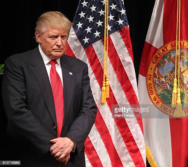 Republican presidential candidate Donald J Trump pauses for a moment of prayer after greeting the small crowd at the Miami Dade College Koubek Center...