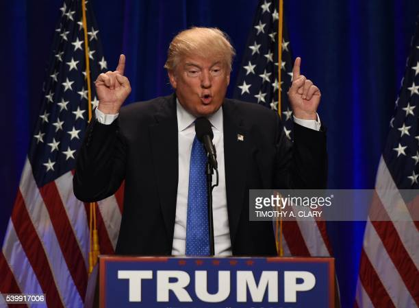 TOPSHOT Republican presidential candidate Donald J Trump speaks at the Saint Andelm College New Hampshire Institute of Politics in Manchester New...