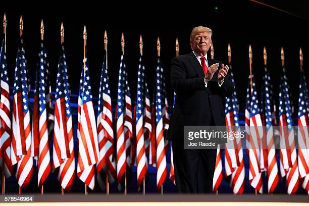 Republican presidential candidate Donald Trump acknowledges the crowd during the evening session on the fourth day of the Republican National...