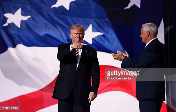 Republican presidential candidate Donald Trump acknowledges Republican vice presidential candidate Mike Pence after he delivered a speech on the...