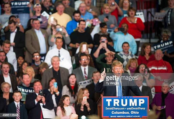 Republican presidential candidate Donald Trump addresses supporters during a campaign rally at the Greater Columbus Convention Center on November 23,...