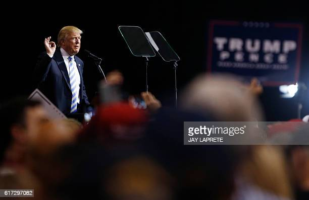 Republican presidential candidate Donald Trump addresses supporters during a campaign rally in Cleveland, Ohio on October 22, 2016. / AFP / Jay...
