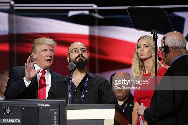 Republican presidential candidate Donald Trump and his daughter Ivanka Trump work with technicians to properly adjust the teleprompters and...